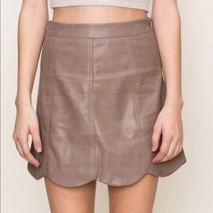 Scalloped faux leather mini skirt